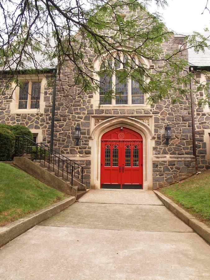 Sidewalk And Red Church Doors Stock Photos