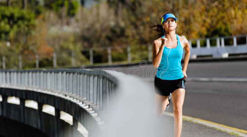 Sidewalk running woman royalty free stock photos