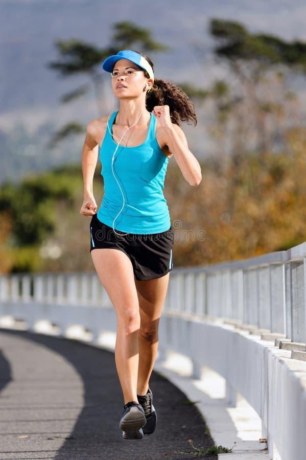 Sidewalk running woman stock image