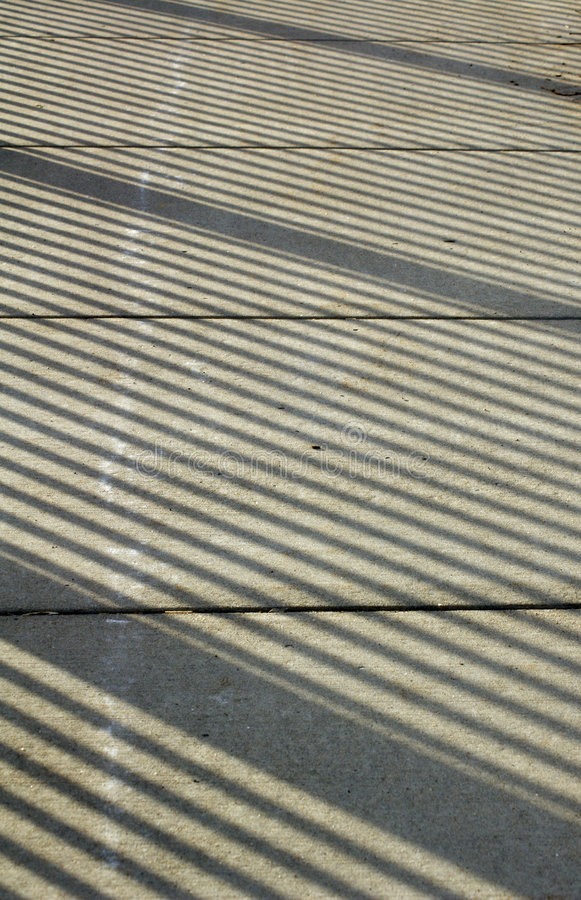 Free Sidewalk Shadow Patterns Royalty Free Stock Image - 611796