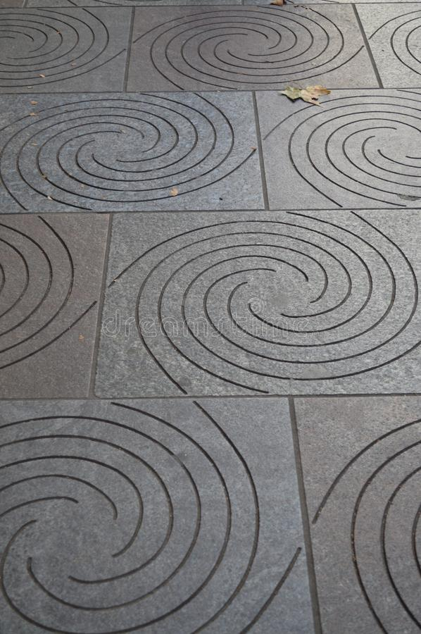 Sidewalk Swirly Design. Cool Swirly pattern on walkway in London, England royalty free stock photo
