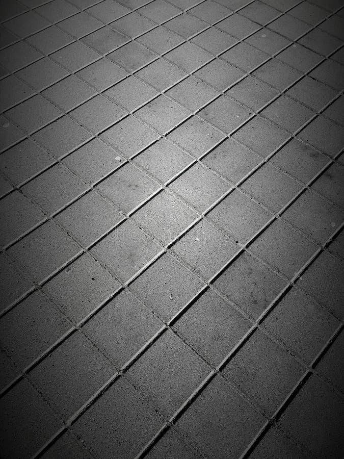 Sidewalk tiles pattern royalty free stock photo