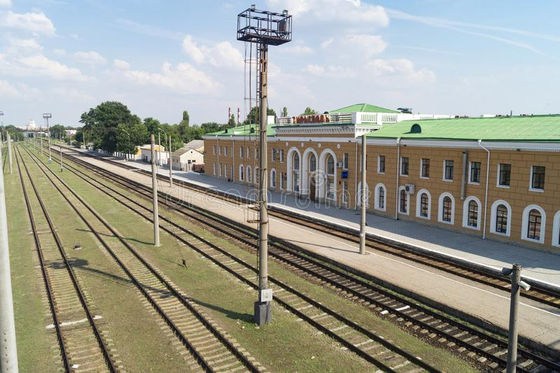 Tiraspol station. Sidewalks for passengers and tracks of tiraspol train station as the second largest city in Moldova, but is effectively the capital and stock image
