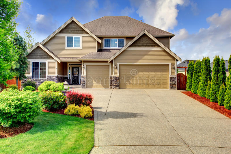 Siding House With Stone Trim And Tile Roof Stock Photo