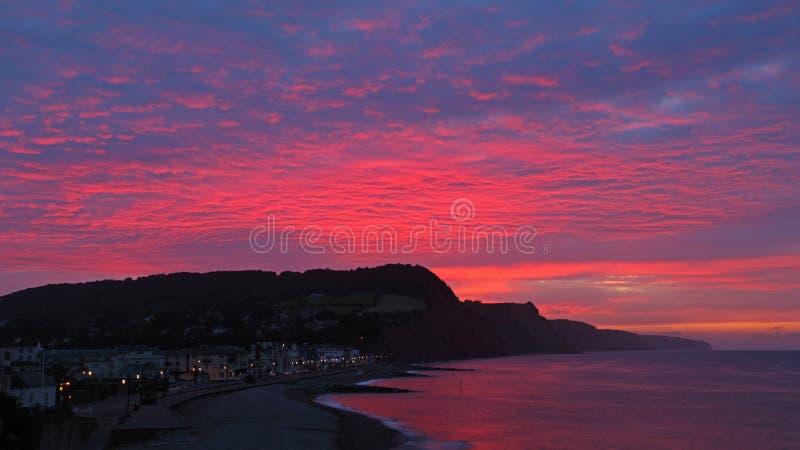 Sidmouth brennender Sonnenaufgang stockbild