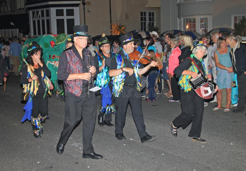 SIDMOUTH, DEVON, ENGLAND - AUGUST 10TH 2012: A group of musicians dressed in decorated top hats and ragged blue waistcoats take stock image