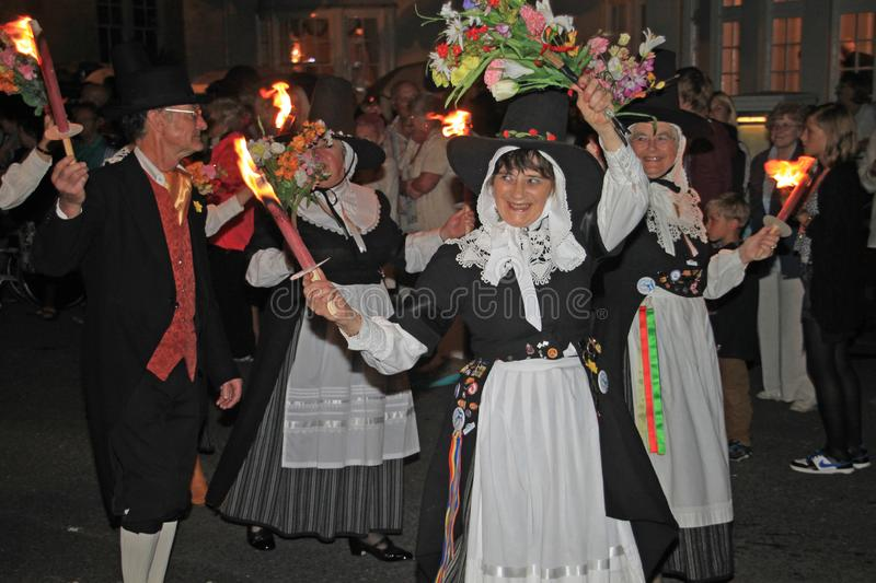 SIDMOUTH, DEVON, ENGLAND - AUGUST 10TH 2012: A group of Welsh performers takes part in the night time closing procession of folk stock photography