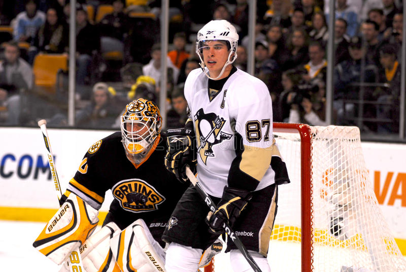 Sidney Crosby and Tim Thomas. Pittsburgh Peguins (F) Sidney Crosby and Boston Bruins goalie Tim Thomas royalty free stock images