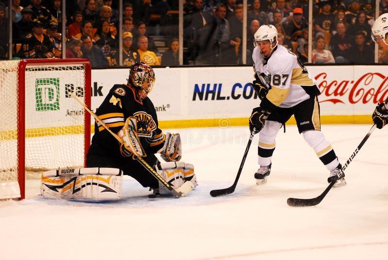 Sidney Crosby -- Tuukka Rask. Pittsburgh Peguins superstar Sidney Crosby tries to tip the puck past the five hole against Boston Bruins goalie Tuukka Rask stock photos