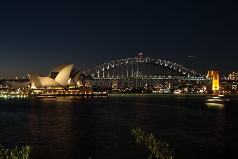 Sidney opera nightshot. Illuminated with habour bridge royalty free stock image