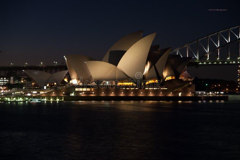 Sidney opera nightshot. Illuminated with habour bridge stock photography