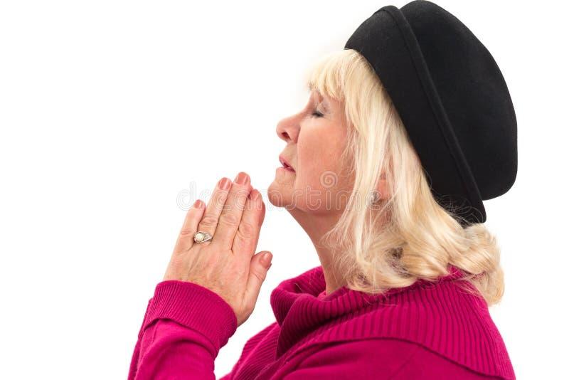 Sidosikt av att be för kvinna royaltyfri foto