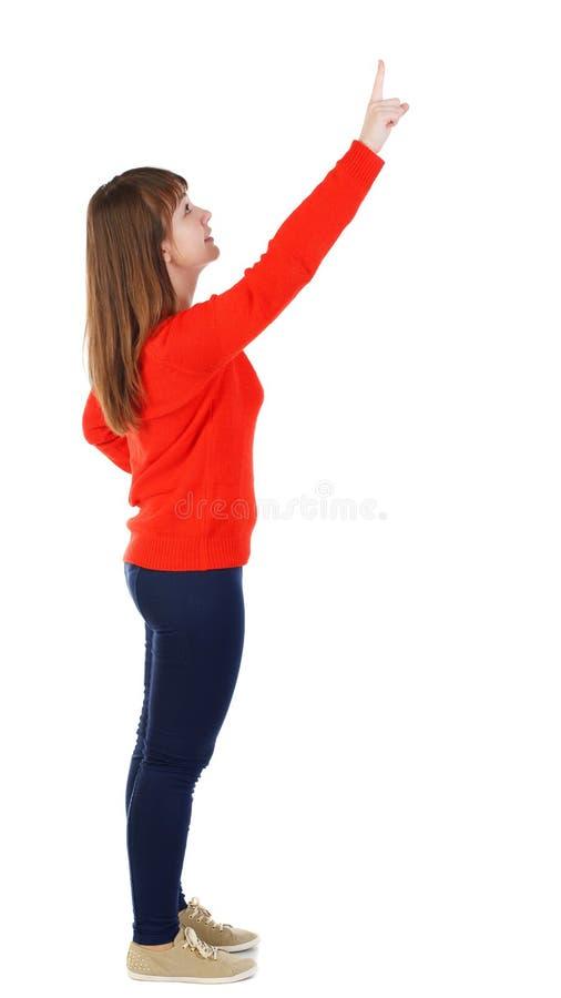 Sidosikt av att peka kvinnan härlig flicka arkivbild
