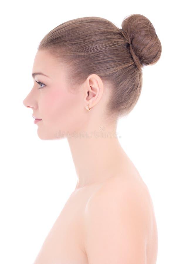 Sidosikt av den unga härliga kvinnan med perfekt hud som isoleras på arkivfoto