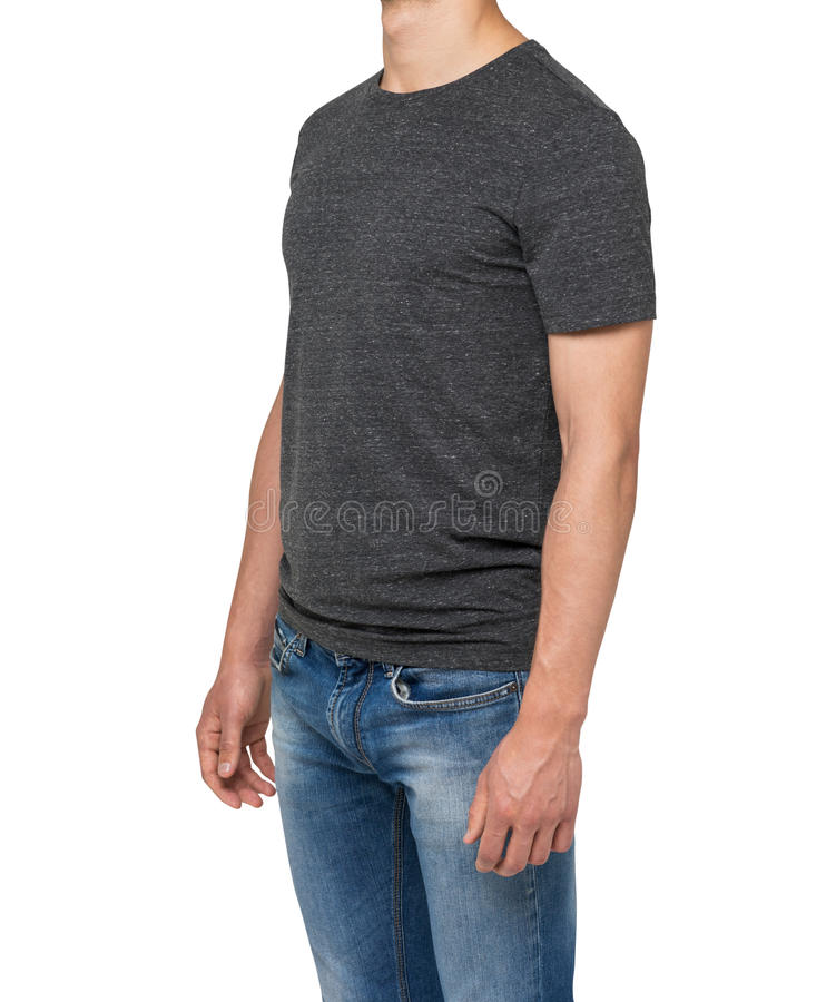 Sidosikt av en man i en mörk grå t-skjorta och grov bomullstvill royaltyfria bilder