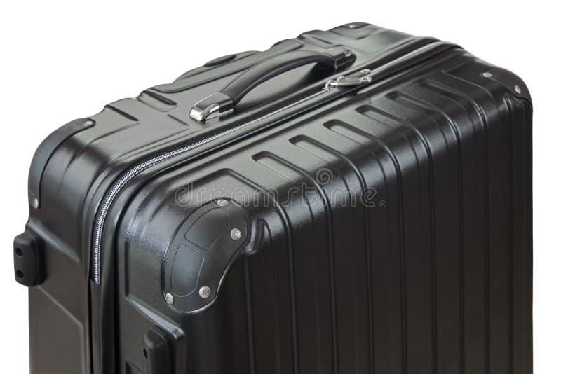 Sidosikt av en stor lättvikts- hård beskjuten resväskafokus av bu royaltyfri foto