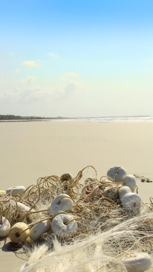 Sieć rybacka plażą obrazy royalty free
