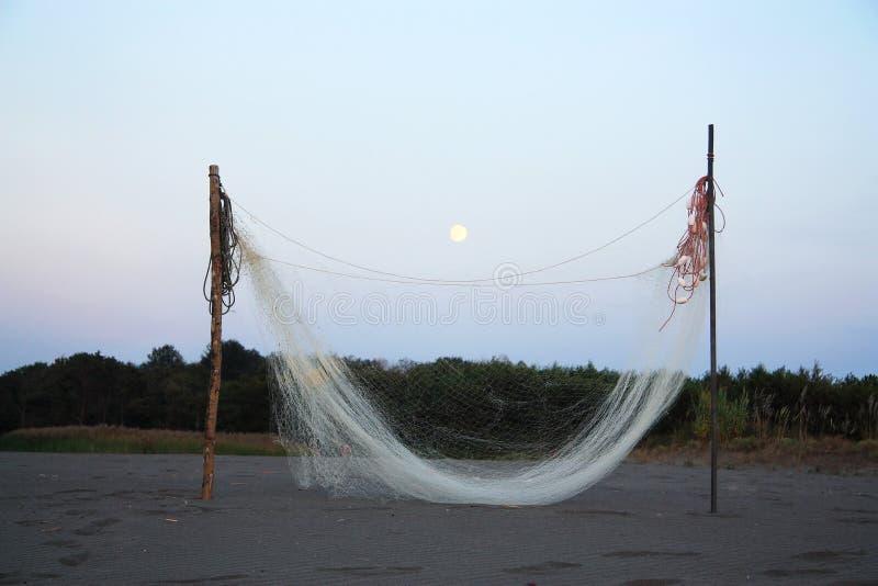 Sieć rybacka suszy późnego lipa wieczór zdjęcie stock