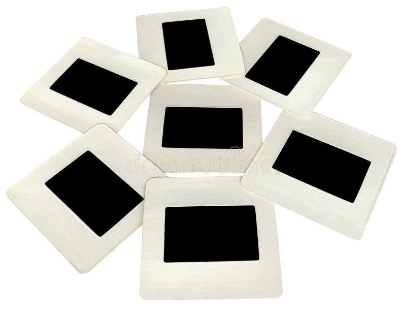 sieben schwarze Plättchen mit weißen Feldern, lightbox lizenzfreie stockfotos