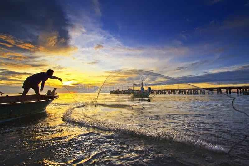 sieci rybackiej zmierzchu miotanie zdjęcie stock