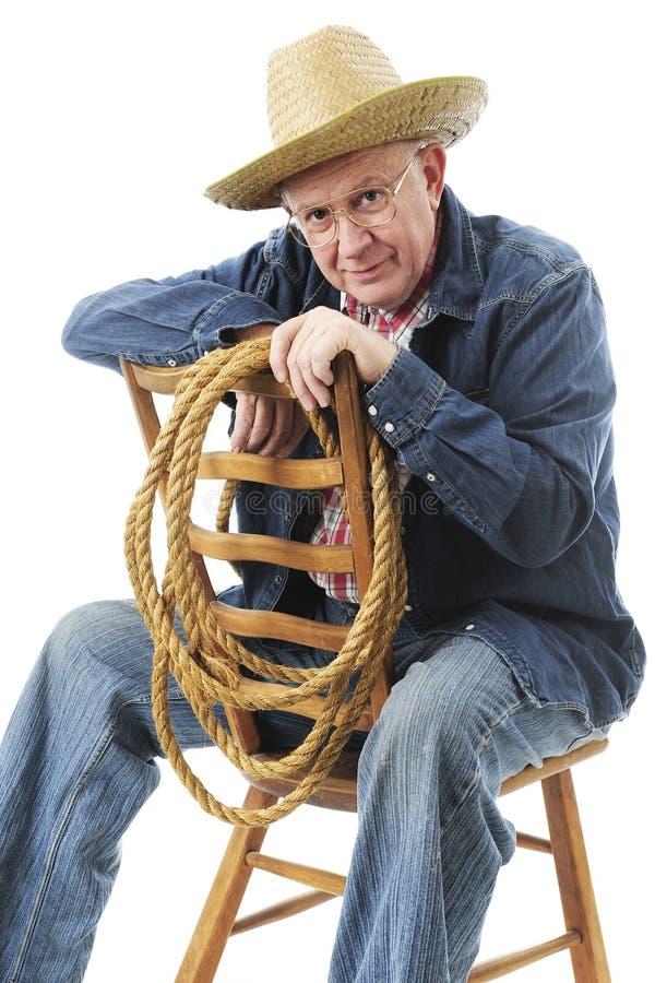 Siedzący Starszy kowboj obraz royalty free