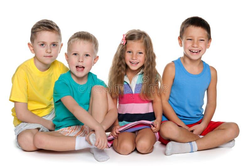 Siedzieć cztery rozochoconego dziecka zdjęcie stock