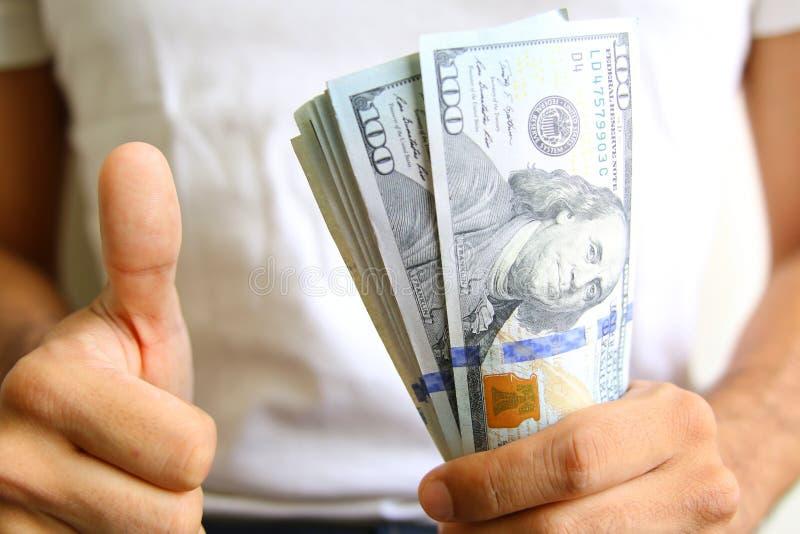 Siegervertretungsgewinne Verbreitung des Bargeldes stockfotografie