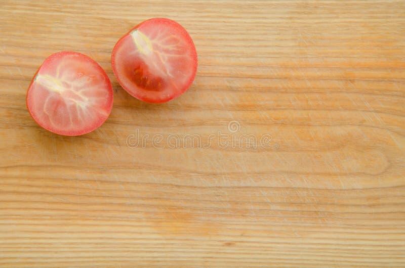 Download Siekający pomidor zdjęcie stock. Obraz złożonej z łasowanie - 53789408