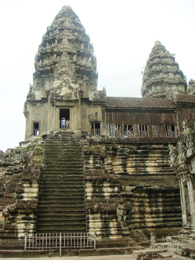 Siem Reap buildings and temples Cambodia. Siem Reap giant historical ancient temples and buildings some restored and some overgrown by trees in Cambodia stock images
