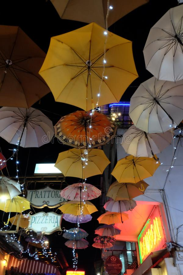 Multi-colored umbrellas are hung over the city street. Lots of hanging umbrellas. Night. Siem Reap, Cambodia, December 23, 2018 multi-colored umbrellas are hung stock photos
