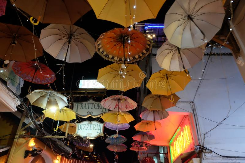 Multi-colored umbrellas are hung over the city street. Lots of hanging umbrellas. Night. Siem Reap, Cambodia, December 23, 2018 multi-colored umbrellas are hung stock images