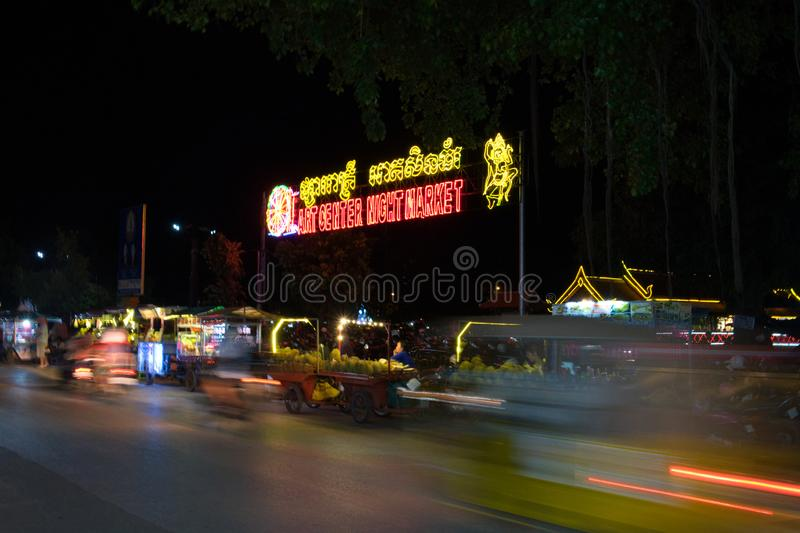Night market, traffic on the road, motion blur stock photography