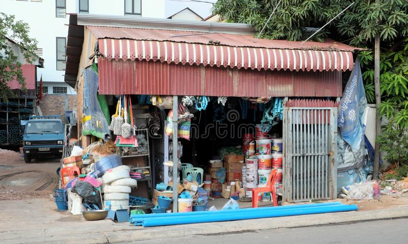 Small shop of industrial goods. A small blue car near the store stock photography