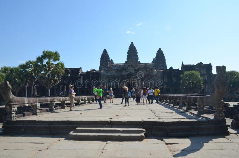 SIEM REAP, CAMBODIA - December 11, 2015: Tourists walk and take pictures at the Angkor Wat temple stock photos