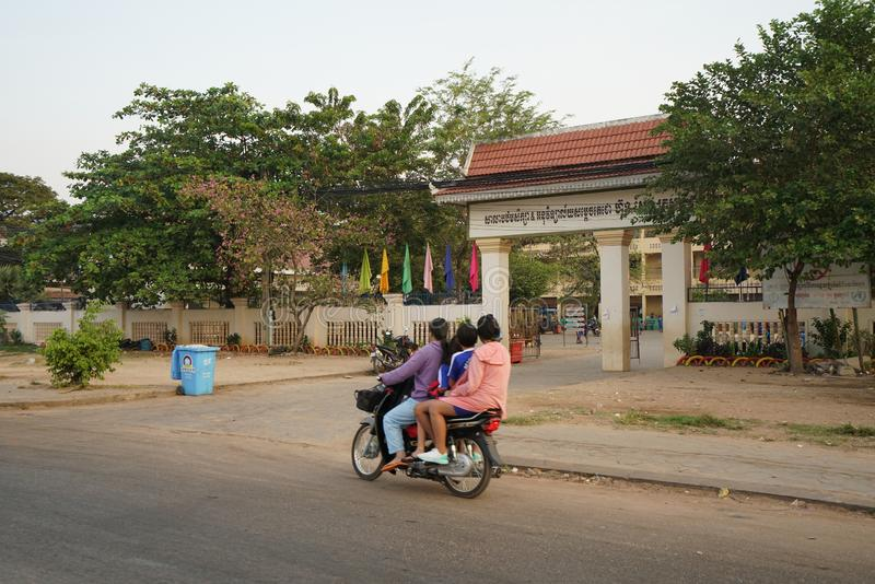 Four persons riding on one motorcycle heading for a school on National Highway 6 in Siem Reap, royalty free stock photos