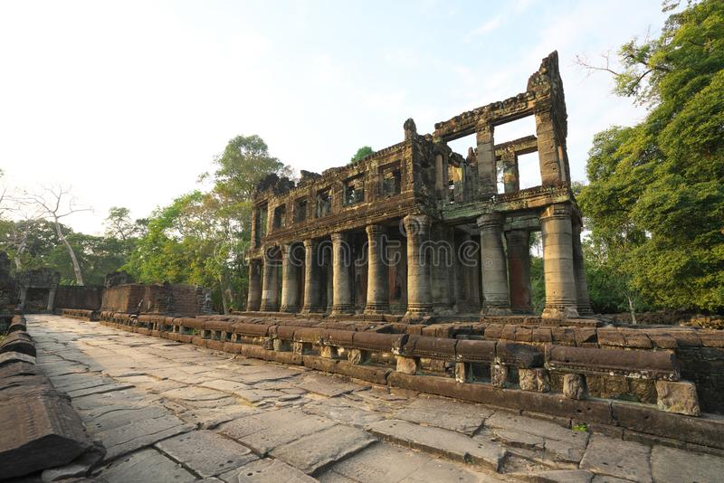 A two-storied temple with round columns in Preah Khan, Siem Reap, Cambodia. Siem Reap,Cambodia-Januay 12, 2019: A two-storied temple with round columns in Preah royalty free stock image