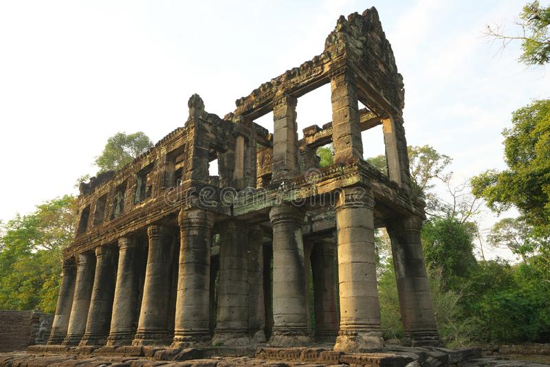 A two-storied temple with round columns in Preah Khan, Siem Reap, Cambodia. Siem Reap,Cambodia-Januay 12, 2019: A two-storied temple with round columns in Preah royalty free stock images