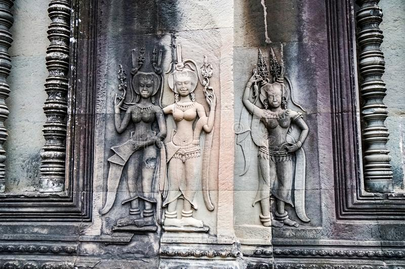 Image of naked women, concubines, on the wall of Angkor Wat. Siem Reap, CAMBODIA - July 17, 2019: stone image of naked women, concubines, on the wall of Angkor stock photos