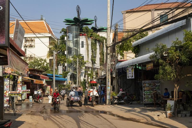 Siem Reap, Cambodia - 25 March 2018: street view with mopeds and restaurants. Street life of modern asian city. Tourism industry in Cambodia. Streetview with stock photos