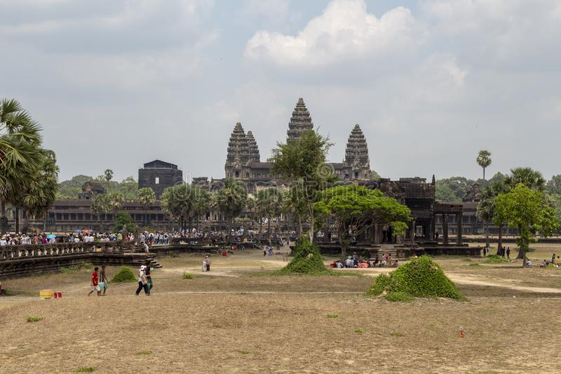 Siem Reap, Cambodia - 22 March 2018: Tourists in temple of Angkor Wat complex, Cambodia. Angkor Wat iconic landscape. Tour group sightseeing. Khmer stock photo