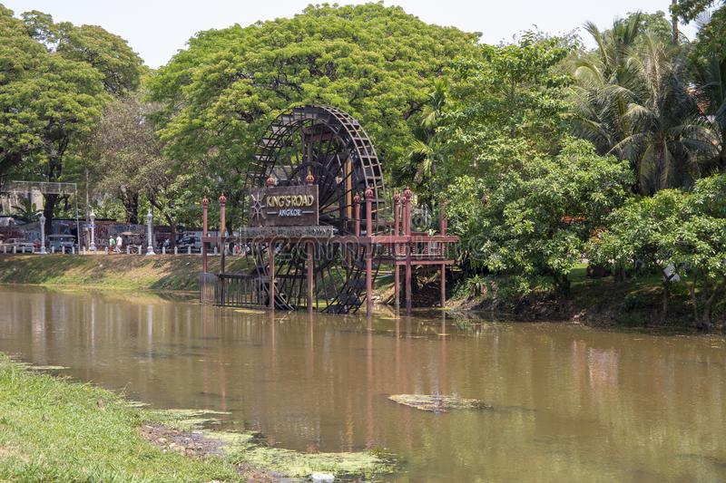 Siem Reap, Cambodia - 25 March 2018: water mill wheel on river. Historical place in Cambodia. Watermill wheel. On green river. Rustic lifestyle of khmer people stock photo