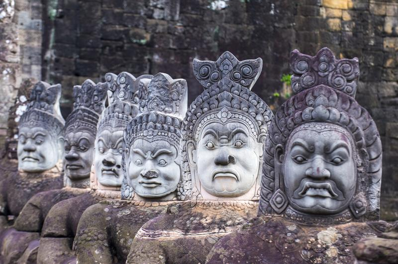 Angkor Thom Cambodia. SIEM REAP , CAMBODIA - OCT 15 : Statues at the South Gate of Angkor Thom, Siem Reap Cambodia on October 15 2017 , Angkor Thom was the last royalty free stock photos