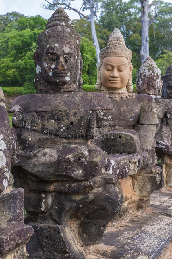 Angkor Thom Cambodia. SIEM REAP , CAMBODIA - OCT 15 : Statues at the South Gate of Angkor Thom, Siem Reap Cambodia on October 15 2017 , Angkor Thom was the last royalty free stock photography