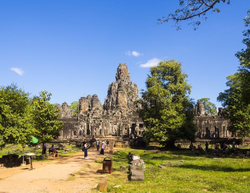 Siem Reap Cambodja - Bayon tempel i Angkor vikarier arkivbild