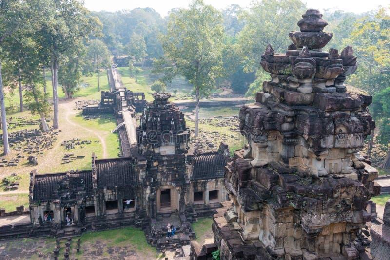 Siem Reap Cambodja - December 10 2016: Baphuon tempel i Angkor Thom royaltyfri bild