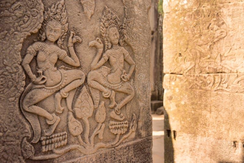 Siem Reap Cambodja - December 08 2016: Lättnad på den Bayon templet i Ang royaltyfria bilder