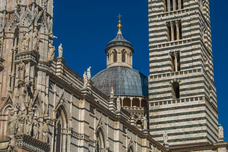 Siena Cathedral closeup with dome and statue as the famous landmark in medieval town stock images