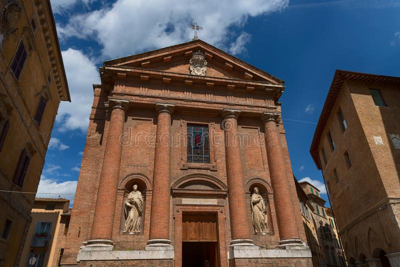 SIENA, ITALY – MAY 25, 2017: Beautiful spring cityscape. Church of Saint Christopher San Cristoforo royalty free stock images