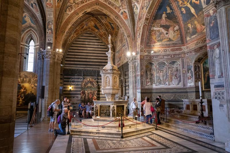 Panoramic view of interior of Battistero di San Giovanni. Siena, Italy - June 28, 2018: Panoramic view of interior of Battistero di San Giovanni is a religious royalty free stock photography