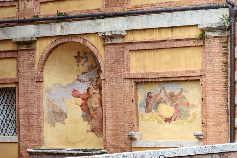Old fresco on the wall of Palazzo Pannilini in Siena. Italy royalty free stock image